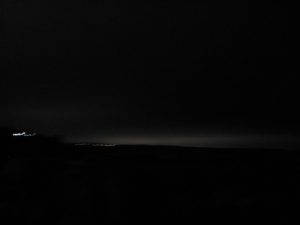 looking out to the North Sea and the night glow of Dundee to the north