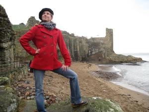 me posing on the beach below the Castle
