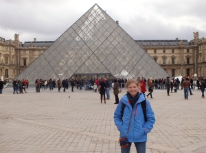 Posing in front of the famous Louvre pyramid