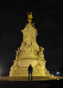 posing in front of the Victoria Memorial, across from the palace.