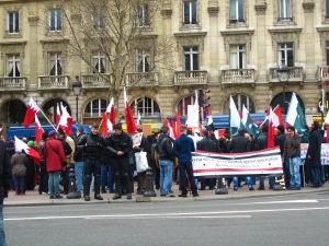 """We witnessed the beginning of a pro-regime Syrian protest in the middle of Paris. The banner reads: """"Syria will always be fortified against penetration  As long as we believe in it."""" There were riot police EVERYWHERE."""