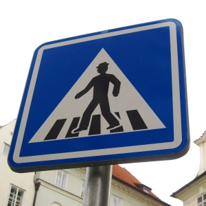 """This was the street sign for a pedestrian crossing; every time we saw one I grinned, because it reminded me of Billy Joel's song, """"Piano Man.""""  All I can see when I look at it is a man dancing on giant piano keys!"""