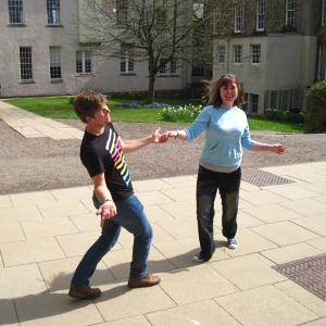 Lawrence and Laura, my academic parents, swing dancing outside of the Library