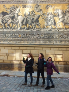 Hannah, Anna, and Christabel posing like some of the figures on the wall.