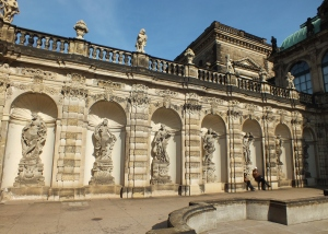 An interior courtyard of the Zwinger; statues lined all of the walls surrounding a fountain.