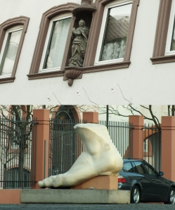Top: Statue over the doorway of a building.  I love little architectural details! Bottom: a random sculpture of a foot--I'm not certain whether there was actually more to it at one point, or what its significance is.