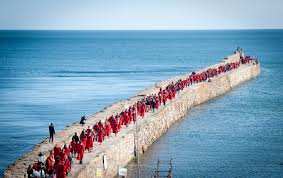 Students walking along the pier in their red robes!