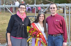 Cate Cardinale was crowned the 2013 homecoming queen. To her left and right are student body VP Hannah Collins and student body President Daniel Prohaska.