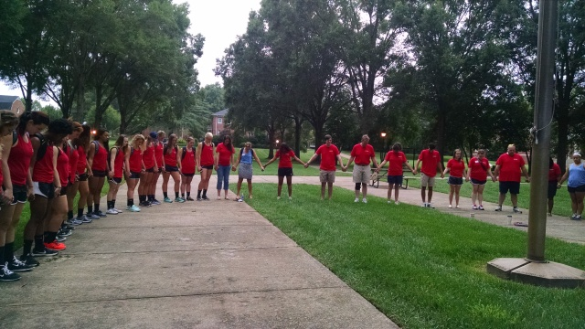 Orientation staff and volunteers gathered around Erskine's flagpole on Move In Day morning to pray for Orientation.